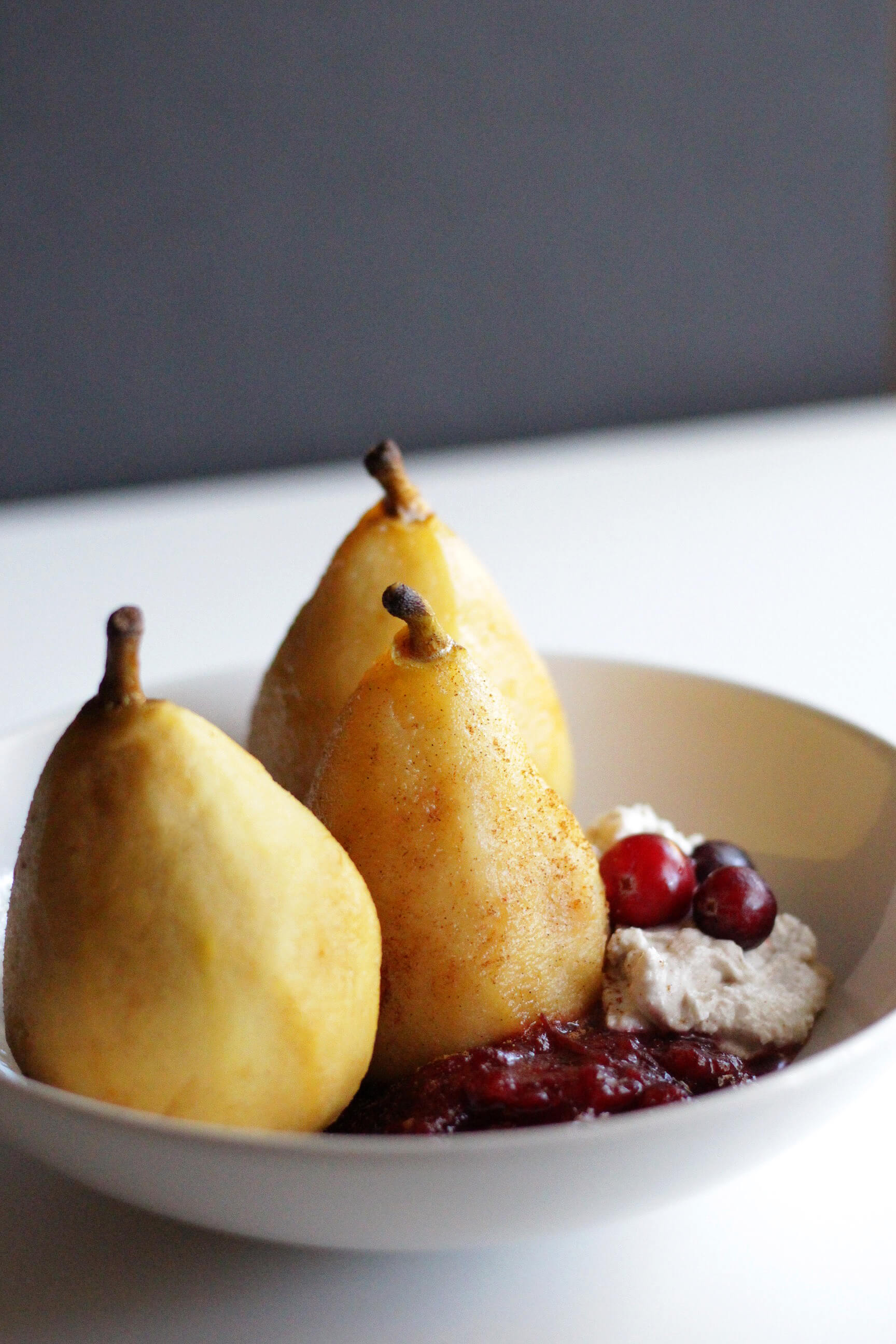 poached pear with cranberry compote